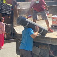 Bhutanese and Karmarong Group Bringing in the Materials