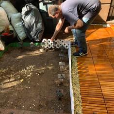 Sangha setting up the Garden