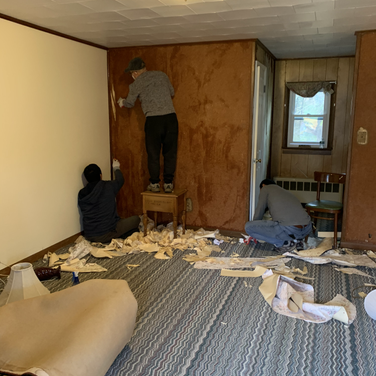 The Bhutanese group removing wallpapers from each room
