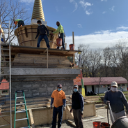 The Karmarong filling the Stupa's bumpa section with cement