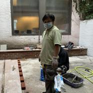 The Karmarong lying the bricks for the backyard garden ground