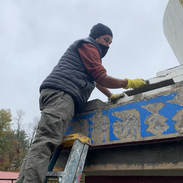 Lopon Jampal laying cement on the stupa