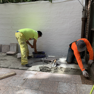 The Karmarong laying the bricks for the backyard garden