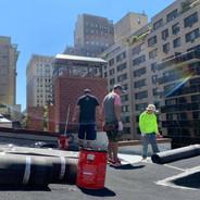 Karmarong Group preparing materials to repair the roof