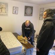Misun, John and Richie disassembling the bed