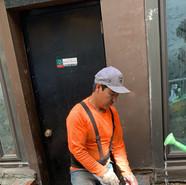 Dawa Tsering preparing the cement