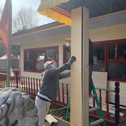 The Karmarong setting up the wooden boards for the pillars