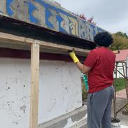 Volunteering Sangha Members laying cememnt on the stupa
