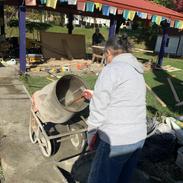 Lama Dorji mixing the cement