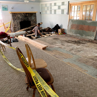 Michael installing beams under the floor