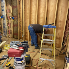Jake preparing a section of the wall to isntall sliding door in the room
