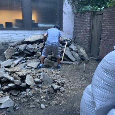Bhutanese Sangha Members Removing Rocks from Backyard Garden