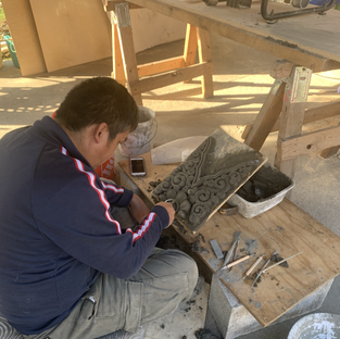 Lopon Jampal molding the designs for the stupa