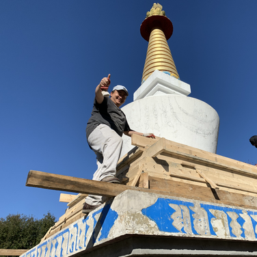 Lopon Lulu and Lopon Jampal filling the upper part of the stupa with cement