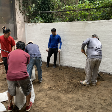 The Karmarong preparing the ground for cement and brick tiles
