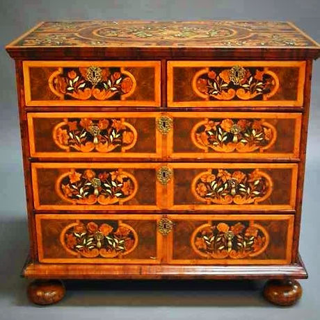 Antique marquetry chest after restoration and french polishing
