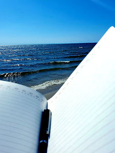 Journal and pen on beach | Write Your Heart Out | Sandra Mitchell | Writer. Marketer. Coach | Grand Rapids, Grand Haven, Muskegon, Holland, Michigan