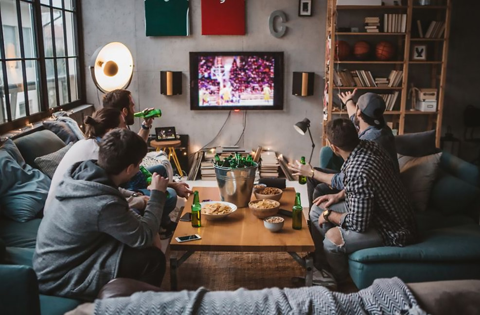 Sports Fans watching TV living room beer