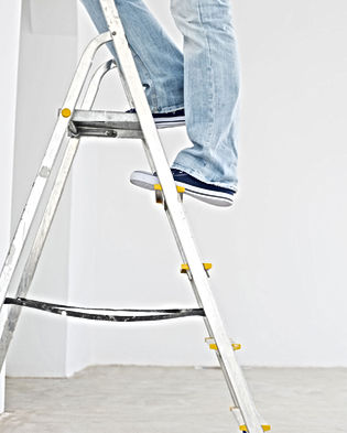 step ladder with man with a person on them