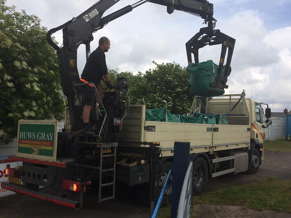 Huws Gray Supporting Winsford United by generoulsy donating materials needed for pitch maintenance