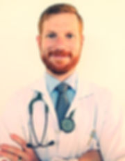 Red headed 35 year male old mdoctor smiling with clean red beard and freckles clean hair cut with a light blue shirt and dark blue tie and a whit lab coat. Has a dark green Littmann stethescope around neck. Has a silver and gold cross pen in left side pocket of lab coat. White background