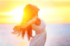 Woman Feeling Liberated with Sunset in Background