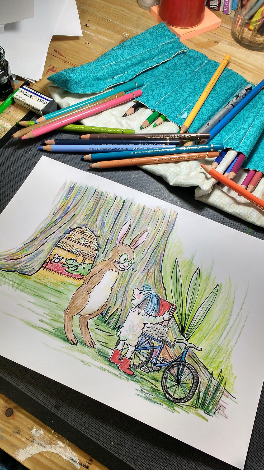 Illustration en cours et crayons de couleurs