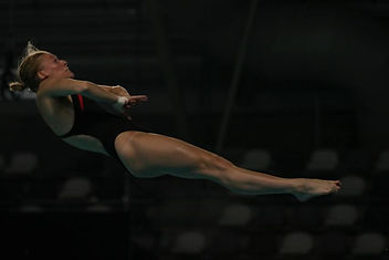 Competing as a 3 & 10 meter diver.