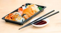 close-up-photo-of-sushi-served-on-table-
