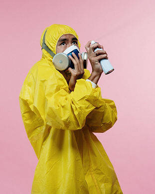 person-in-yellow-coveralls-holding-spray