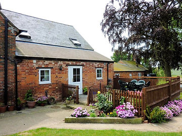 The Granary has a patio area at the rear of the cottage
