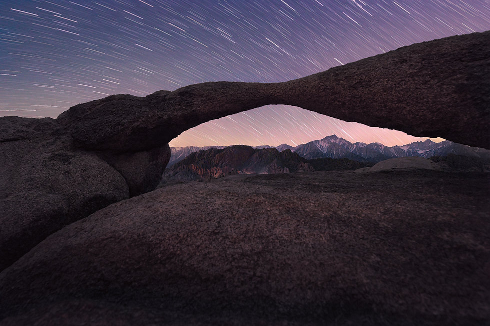 Star trails over the Lathe Arch in Alabama Hills, California