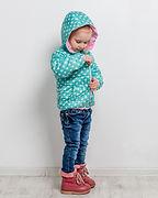 little girl fastening her blue dotted ja