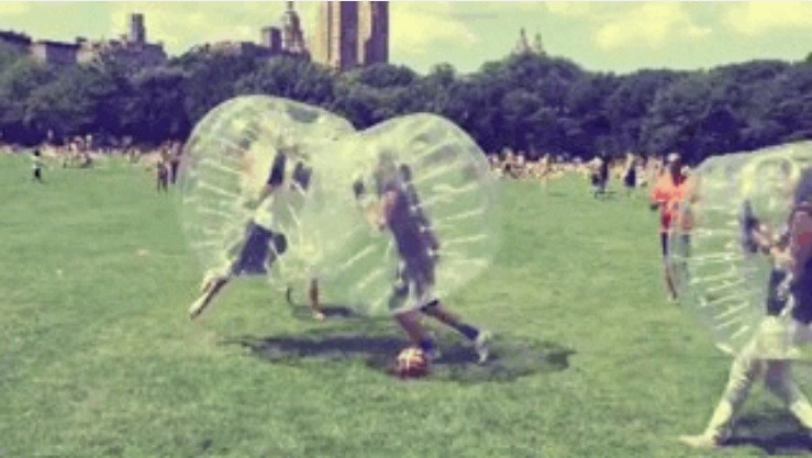 Kids in a bubble suit playing