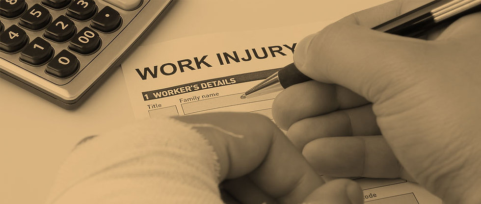 Injured person filling out worker's comp claim papers.