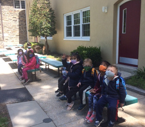 Admissions-children outside2 on bench with backpacks 5.2021 (1).JPG