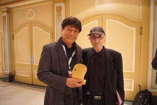 golden zenith with fest director.jpeg