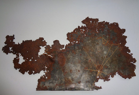 """Julie Corcoran, """"Initial,"""" 2020, rusted salvaged tin, button thread."""