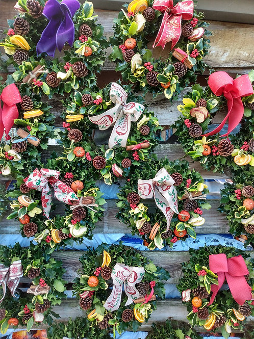 Christmas wreath on moss frame.