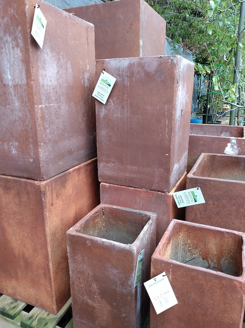 Rusty terracotta, tall, square pots. Prices from: