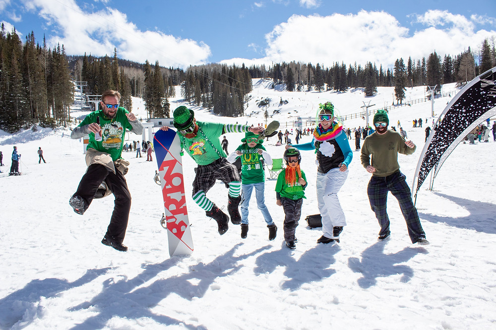 Leprechauns kicking heels in snow!