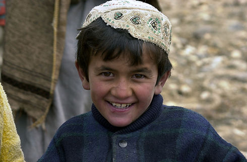 a-local-afghan-boy-poses-with-a-big-smil