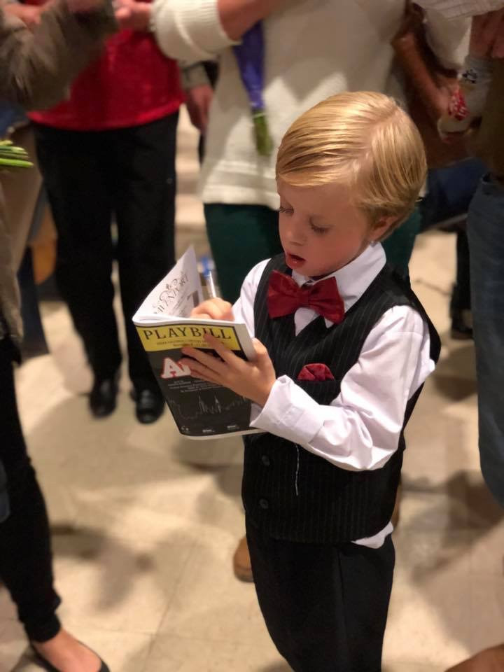Cohen signing Playbills while in Annie at Greer Cultural Center