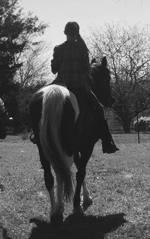 Rennah riding a horse.