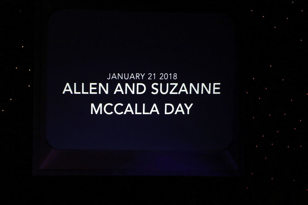 Powerpoint announcing January 21st, 2018 as Allen and Suzanne McCalla Day