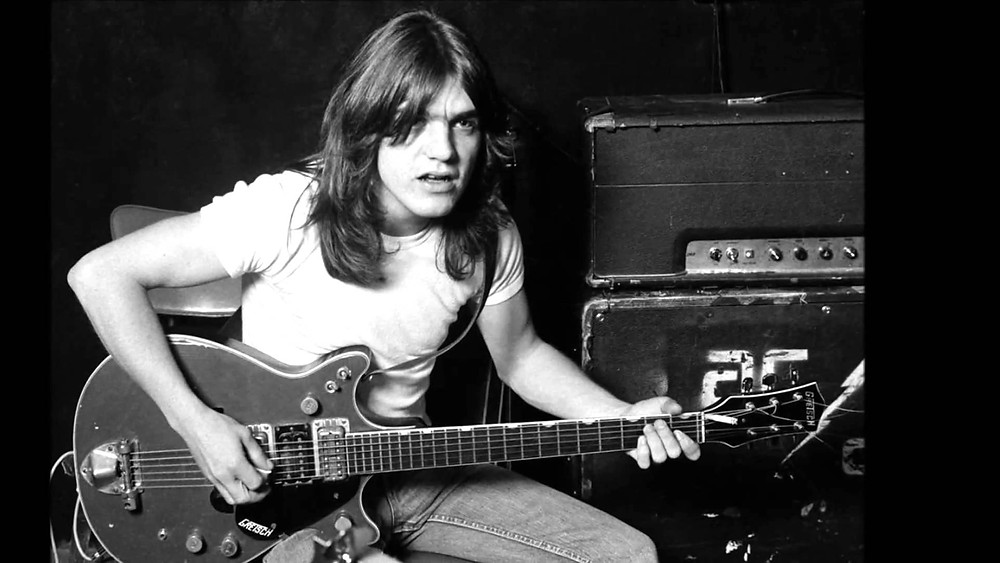 Malcolm Young playing guitar for AC/DC