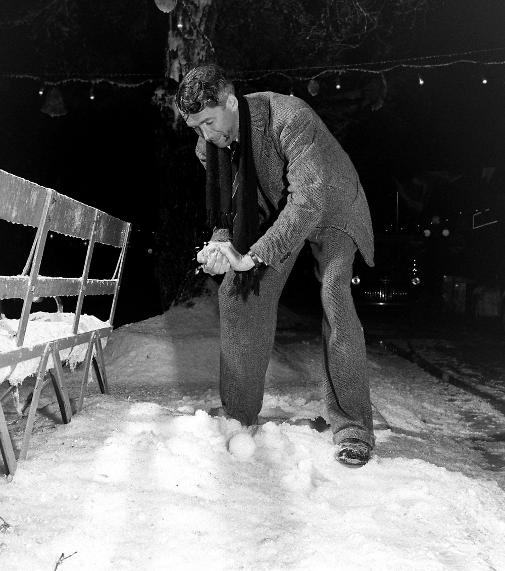 Jimmy Stewart goofing off on the set of It's A Wonderful Life