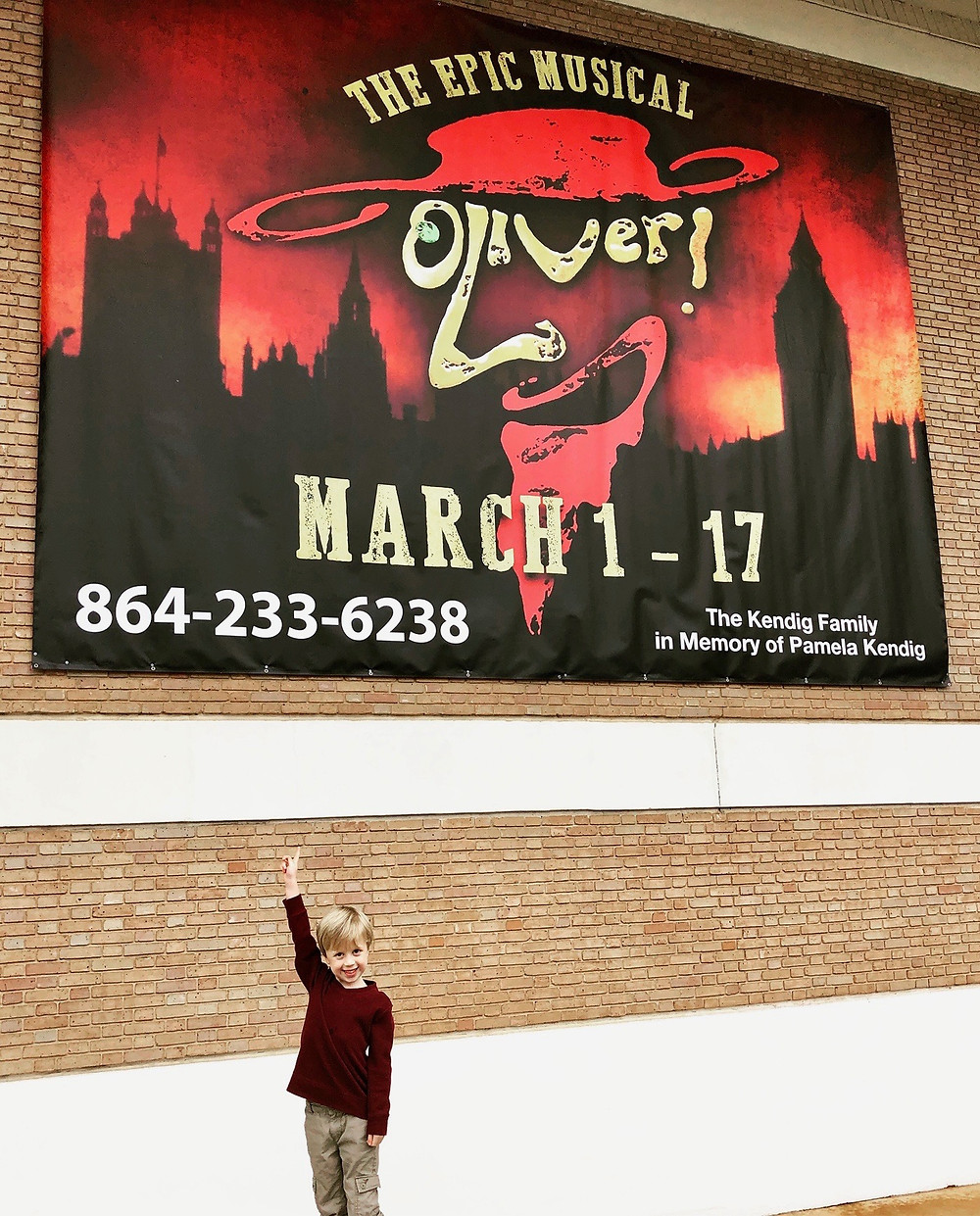 Cohen underneath the Oliver banner at Greenville Theatre.