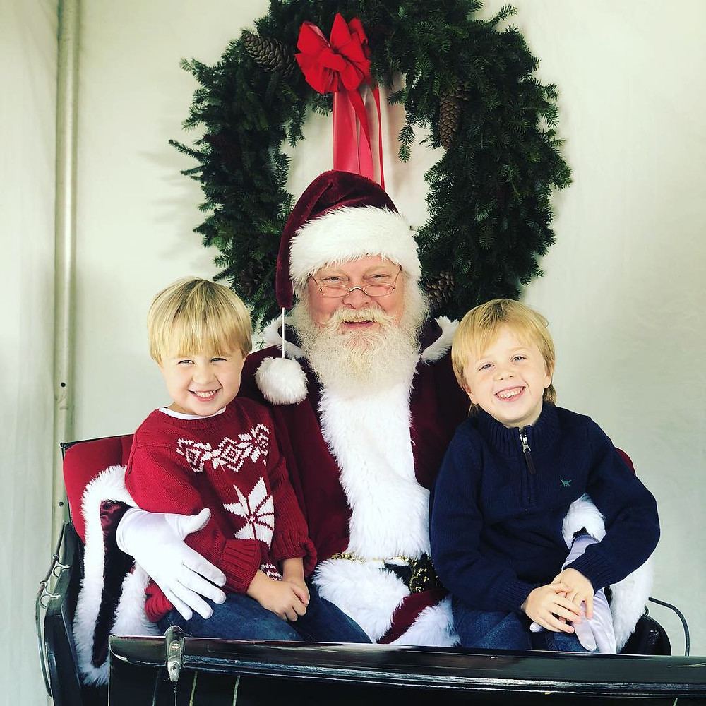Cohen and his younger brother Cameron with Santa.