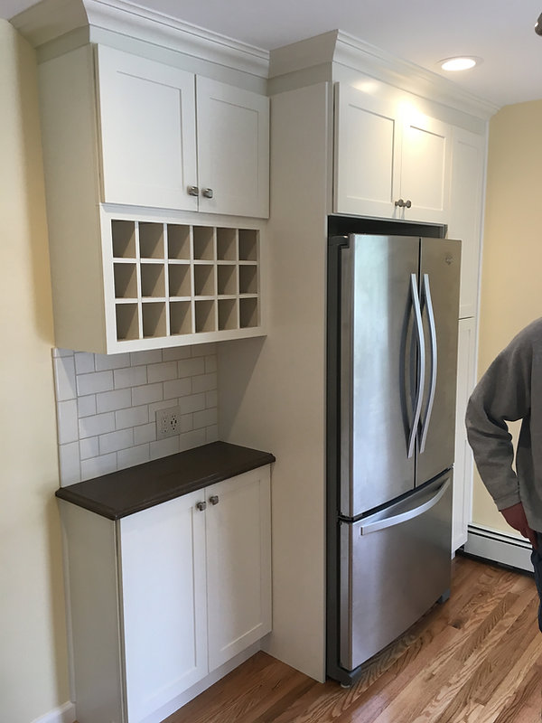 New kitchen cabinets, appliances, flooring and crown moulding,